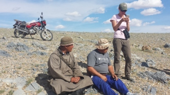Our driver and a sheepherder friend (note the motorbike in the background, as herders prefer to save the wear and tear on their much prized horses) take a well-deserved break.