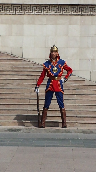 Dressed in traditional outfits this guard parades before The Government building in Sukhbaatar square.