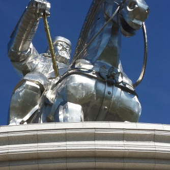 The capital of Mongolia, Ulaanbaator, is a bustling city of contrasts with striking accents of its rich history and promising future. Here a commanding statue of its most prominent native son, Chinggis Khan, looks out over the central city plaza.